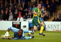 Photograph:Scott Heavey.<br />Gillingham v West Bromwich Albion. Nationwide Duvision one. 04/10/2003.<br />Scott Dobie slides the ball past Jason Brown (grounded) to take the Baggies in to a 0-1 lead