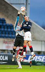 Falkirk's Farid El Alagui goes in on keeper Michael Fraser..Falkirk 1 v 1 Ross County, 26/12/2011..Pic © Michael Schofield..