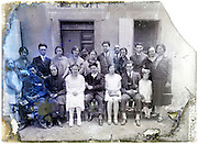 wedding families large group portrait on a severely eroding and broken glass plate