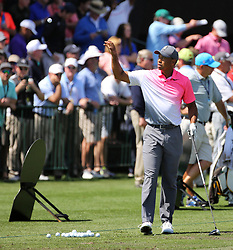 March 16, 2018 - Orlando, FL, USA - Tiger Woods catches a ball from his caddy during driving practice on the second day of the Arnold Palmer Invitational at Bay Hill Friday, March 16, 2018 in Orlando, Fla. (Credit Image: © Joe Burbank/TNS via ZUMA Wire)