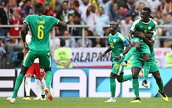 Senegal's Idrissa Gueye (right) celebrates his side's first goal of the game with team-mates Salif Sane (left) and Sadio Mane