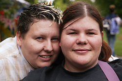 A portrait of a couple of women at the Nottingham Pride Gay Lesbian festival; held at the Arboretum,