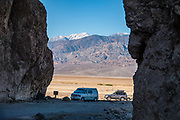 Snow-dusted Telescope Peak, seen from Golden Canyon Trailhead, in Death Valley National Park, California, USA. Cresting the Panamint Range, snow-dusted Telescope Peak (11,043 ft) rises to the highest point in the Park. Telescope Peak has one of the greatest vertical rises above local terrain of any mountain in the contiguous United States.