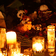 Candle's a cuddly toy's at a shrine around the statue of Mother Mary at the Rose Lima church in Newtown Sandy Hook after yesterday's shootings at Sandy Hook Elementary School, Newtown, Connecticut, USA. 15th December 2012. Photo Tim Clayton