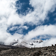 The rocky, rugged apline desert on Mt Kilimanjaro Lemosho Route. These shots were taken on the trail between Moir Hut Camp and Lava Tower at approximately 14,500 feet. In the distance is the summit, partly hidden by clouds.
