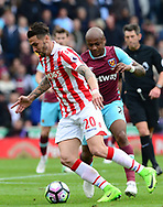Geoff Cameron of Stoke battles with Andre Ayew of West Ham utd. Premier league match, Stoke City v West Ham Utd at the Bet365 Stadium in Stoke on Trent, Staffs on Saturday 29th April 2017.<br /> pic by Bradley Collyer, Andrew Orchard sports photography.