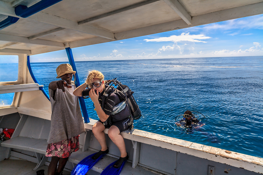 A tourist concentrates before scuba diving into the Indian Ocean in Kenya.
