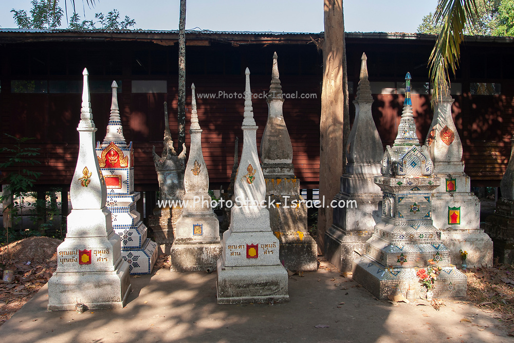 A wooden idol statue in a rural shrine in Northern Thailand