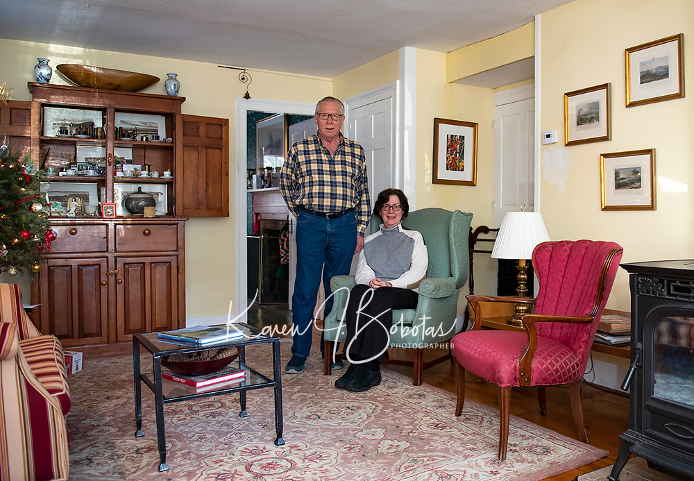 Paul and Kristen Eldridge in the living room of their home.  (Karen Bobotas Photo/for The Laconia Daily Sun)