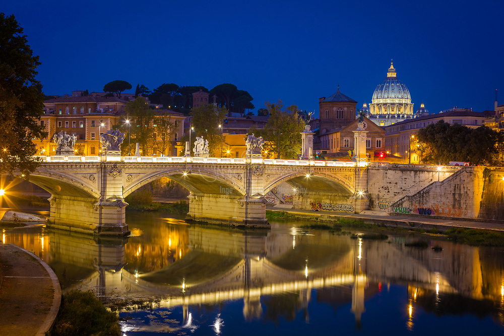 The Mausoleum of Hadrian, usually known as the Castel Sant'Angelo, is a towering cylindrical building in Rome, central Italy, initially commissioned by the Roman Emperor Hadrian as a mausoleum for himself and his family. Seen here above the Tiber River in Rome, Italy.