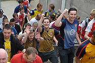 Arsenal fans celebrate their win as the leave after the final whistle as they leave Selhurst Park. Barclays Premier league match, Crystal Palace v Arsenal at  Selhurst Park in London on Sunday 16th August 2015.<br /> pic by John Patrick Fletcher, Andrew Orchard sports photography.