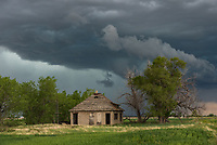 When I passed by this cool looking abandoned house, I knew I had to stop. The sky behind it shows the early stages of a long tracking supercell.