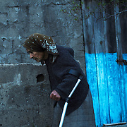 Elderly  woman walking with the help of a cane