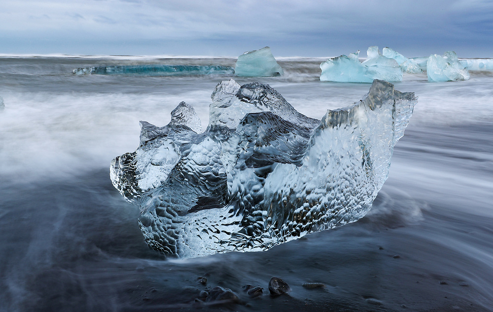 Icebergs are pounded by waves after washing up on shore at Diamond Beach in southeast Iceland. Photo/Andrew Shurtleff Photography, LLC