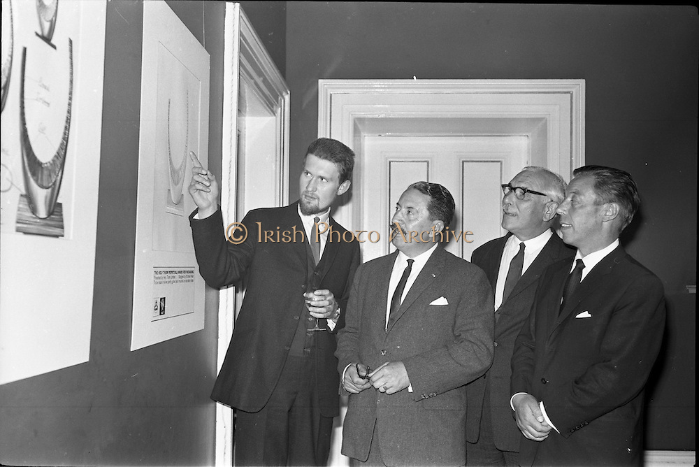 17/06/1963.06/17/1963.17 June 1963.1963 Irish Packaging Competition, reception at the Shelbourne Hotel. The Irish Packaging Institute aimed to raise the standard of packing design and business graphic design in Ireland and held competitions to encourage designers and to aid Irish industry..The 1963 award was sponsored by Hely-Thom Ltd. and named the Hely-Thom Perpetual Award.  Pictured are (l-r) Mr.michael Hilliar, designer of the award, shows his design for the award, to be made in silver to Mr. E.G. O. Ridgwell, General Manager of Irish Packaging Institute, Mr. I.W. Robertson, Sales Director Hely-Thom Ltd. and Mr. Walsh, Coras Trachtala.