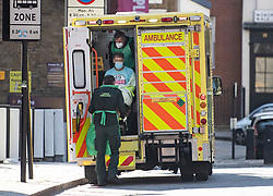 **Face has been pixelated to hide the identity of patient**<br /> © Licensed to London News Pictures. 02/04/2020. London, UK. A member of the public is transported to an ambulance in Euston, Central London, by ambulance workers wearing personal protective clothing and a medical face masks, during a pandemic outbreak of the Coronavirus COVID-19 disease. Members of the public have been told they can only leave their homes when absolutely essential, in an attempt to fight the spread of COVID-19. Photo credit: Ben Cawthra/LNP