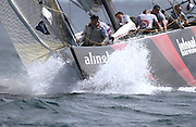 Alinghi bowman Dean Phipps prepares the spinnaker for a set. Race three America's Cup 2003. 18/2/2003  (© Chris Cameron 2003)