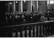 Funeral of Sinead Bean DeValera.    (H82)..1975..09.01.1975..01.09.1975..9th January 1975..Today saw the funeral of Sinead Bean DeValera take place at the Pro Cathedral, Dublin. She was the wife of Ex-President Eamon DeValera. Mrs Devalera was a noted author of childrens literature..Mrs DeValera, Born 3rd June 1878. Died 7th Jan 1975...Image of a grieving Eamon DeValera attending requiem mass for his wife Sinead.