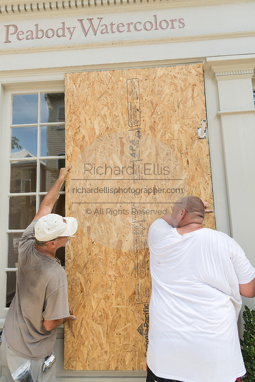 Workers secure plywood covering on a historic building on Church Street in preparation for Hurricane Irma September 8, 2017 in Charleston, South Carolina. Imra is expected to spare the Charleston area but hurricane preparations continue as Irma leaves a path of destruction across the Caribbean.