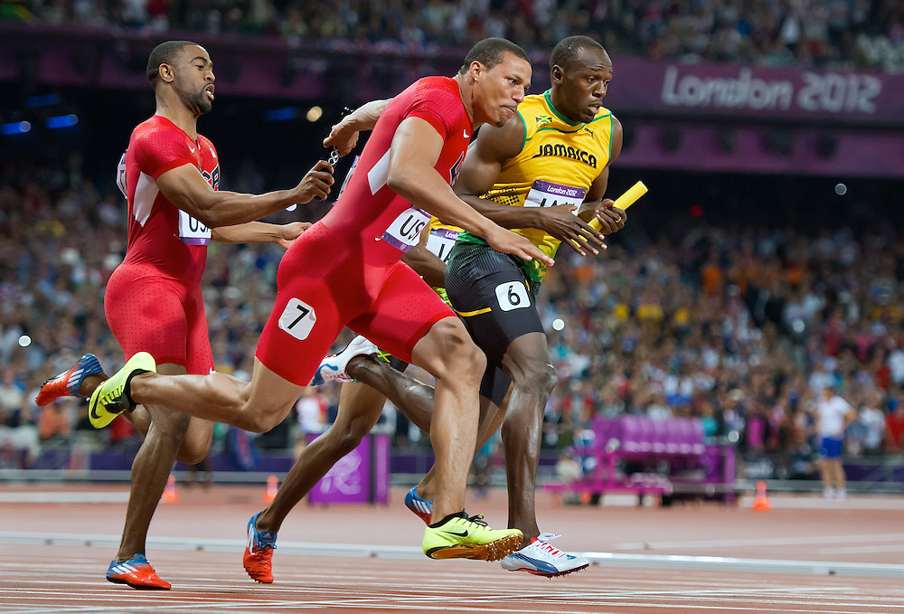 Jamaica's Usain Bolt, right, took the baton on the last leg of the men's 4X100m relay final, setting a world record time of 36.84 at Olympic Stadium during the 2012 Summer Olympic Games in London, England, Saturday, August 11, 2012. At left, Tyson Gay of the United States handed the baton to anchor leg sprinter Ryan Bailey. (David Eulitt/Kansas City Star/MCT)