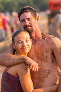 A muddy couple at the 2015 National Red Neck Championships May 2, 2015 in Augusta, Georgia. Hundreds of people joined in a day of country sport and activities.