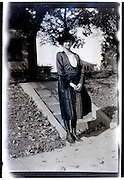 fashionable dressed woman standing in front of house 1920s USA