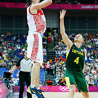 08 August 2012: Russia Alexey Shved takes a jumpshot over Lithuanian Rimantas Kaukenas during 83-74 Team Russia victory over Team Lithuania, during the men's basketball quarter-finals, at the 02 Arena, in London, Great Britain.