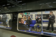 People wearing face masks taking Jubilee Line underground train at Canary Wharf in London, Saturday, March 14, 2020. For most people, the new COVID-19 coronavirus causes only mild or moderate symptoms, such as fever and cough. For some, especially older adults and people with existing health problems, it can cause more severe illness, including pneumonia. (Photo/Vudi Xhymshiti)