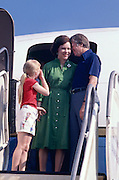 President Jimmy Carter nuzzles the First Lady - Rosalynn Carter on seeing her off on an official mission to South America. Daughter Amy looks on. - To license this image, click on the shopping cart below -