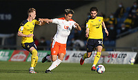 Blackpool's Kenny Dougall gets in between Oxford United's Mark Sykes and Elliot Lee<br /> <br /> Photographer Rob Newell/CameraSport<br /> <br /> Sky Bet League One Play-Off Semi-Final 1st Leg - Oxford United v Blackpool - Tuesday 18th May 2021 - Kassam Stadium - Oxford<br /> <br /> World Copyright © 2021 CameraSport. All rights reserved. 43 Linden Ave. Countesthorpe. Leicester. England. LE8 5PG - Tel: +44 (0) 116 277 4147 - admin@camerasport.com - www.camerasport.com