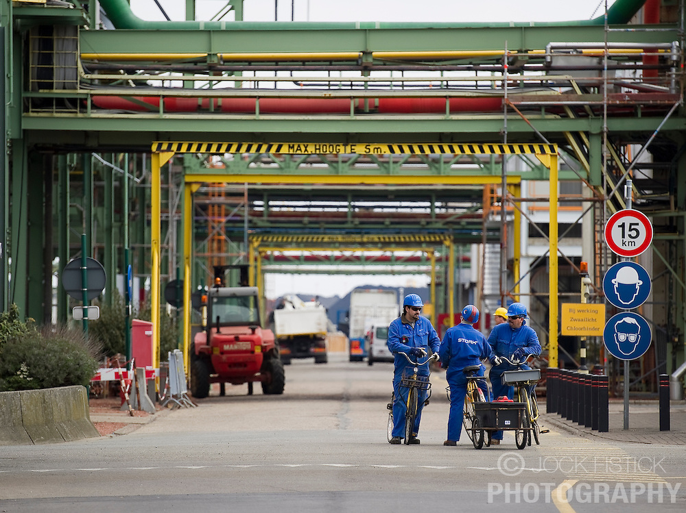 Employees use bicycles for transportation at the Solvay SA chemical plant in Antwerp, Belgium, on Thursday, April 22, 2010. Chlorine and hydrogen peroxide are the main products produced at Solvay's Antwerp facility.  Solvay SA is the world's largest supplier of Soda Ash or Sodium Carbonate and is also a major producer of caustic soda, hydrogen peroxide, chlorine and fluorinated products. (Photo © Jock Fistick)