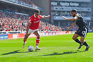 Jacob Brown of Barnsley (33) and Scott Golbourne of Shrewsbury Town (23) in action during the EFL Sky Bet League 1 match between Barnsley and Shrewsbury Town at Oakwell, Barnsley, England on 19 April 2019.