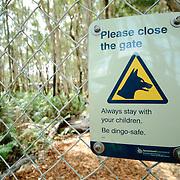 Dingo warning sign at Kingfisher Bay Resort, Queensland, Australia