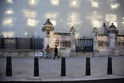 Reflections on a white hoarding from opposite windows against the Palace of Westminster, which is under refurbishment on 15th January 2020 in London, England, United Kingdom.