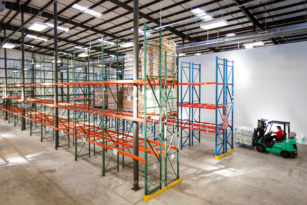 Nearly a month after 4-feet of water swept through the Greater Baton Rouge Food Bank warehouse, staff is working to restock the 170,000 square-foot facilities. Resuming operations at the facility will help the agency get back to receiving and distributing more food to member agencies and the community.