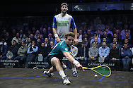 Charles Sharpes of England (in the Green shirt) plays a shot against Simon Rosner of Germany (in the white shirt). Canary Wharf Squash Classic 2016 , day two at the East Wintergarden in Canary Wharf , London on Tuesday 8th March 2016.<br /> pic by John Patrick Fletcher, Andrew Orchard sports photography.
