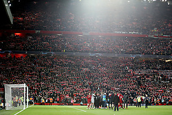 A general view as Liverpool players celebrate in front of the fans in the stands