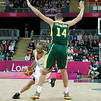 02 August 2012: France Tony Parker drives past Lithuania Jonas Valanciunas during 82-74 Team France victory over Team Lithuania, during the men's basketball preliminary, at the Basketball Arena, in London, Great Britain.