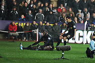 Man city's Yaya Toure (on ground) celebrates after  he scores his sides 2nd goal.  Barclays Premier league, Swansea city v Manchester City at the Liberty Stadium in Swansea,  South Wales on  New years day Wed 1st Jan 2014 <br /> pic by Andrew Orchard, Andrew Orchard sports photography.