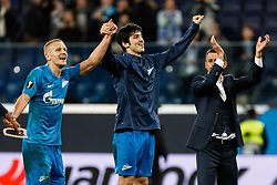February 21, 2019 - Saint Petersburg, Russia - (L to R) Igor Smolnikov, Sardar Azmoun and FC Zenit Saint Petersburg head coach Sergei Semak celebrate victory during the UEFA Europa League Round of 32 second leg match between FC Zenit Saint Petersburg and Fenerbahce SK on February 21, 2019 at Saint Petersburg Stadium in Saint Petersburg, Russia. (Credit Image: © Mike Kireev/NurPhoto via ZUMA Press)