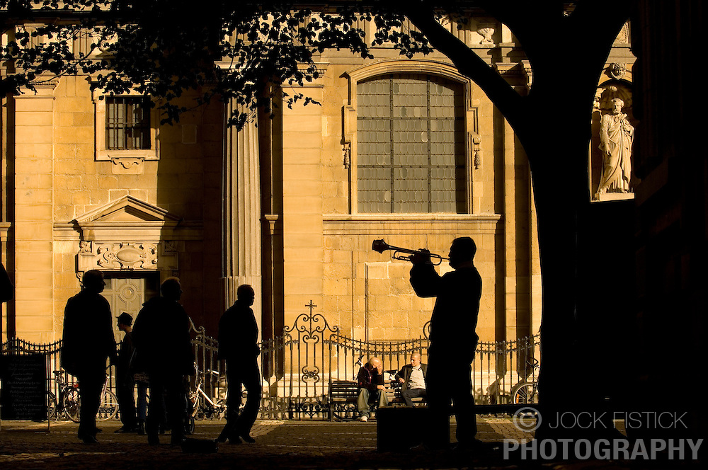 ANTWERP, BELGIUM - OCT-7-2006 - A street musician serenades pedestrians in downtown Antwerp. (PHOTO © JOCK FISTICK)