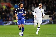Cardiff City's Fabio Da Silva (l) takes on Leeds player  Mirco Antenucci. Skybet football league championship match, Cardiff city v Leeds Utd at the Cardiff city stadium in Cardiff, South Wales on Tuesday 8th March 2016.<br /> pic by Carl Robertson, Andrew Orchard sports photography.