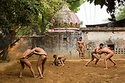 Indian Khusti wrestlers practice at a wrestling Akhara in New Delhi, India. <br /> Pehlwani, or kusti is a form of wrestling from South Asia. It was developed in the Mughal Empire<br /> by combining native malla-yuddha with influences from Persian koshti pahlavani. A practitioner of this sport is referred to as a pehlwan.