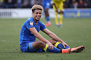 AFC Wimbledon striker Lyle Taylor (33) sat on floor smiling during the EFL Sky Bet League 1 match between AFC Wimbledon and Oxford United at the Cherry Red Records Stadium, Kingston, England on 10 March 2018. Picture by Matthew Redman.