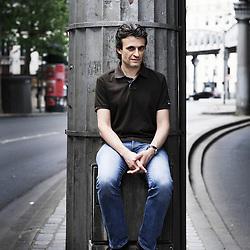 """PARIS, FRANCE. APRIL 27, 2011. French writer Rodolphe Macia, under the subway's line 2, about which he wrote a book: """"Je vous emmène au bout de la ligne"""". (photo Antoine Doyen)"""