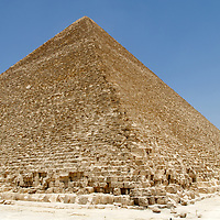 Giza. Cairo. Egypt. View of the North and West faces of the Great Pyramid of Khufu (Cheops) at Giza which is the oldest and largest of the all Pyramids and was built as the mortuary temple for the 4th-Dynasty king Khufu (2589-66 BC). The Pyramid Fields from Giza to Dahshur and Memphis and its Necropolis are together a designated Unesco World Heritage Site.