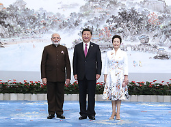 (170904) -- XIAMEN, Sept. 4, 2017 (Xinhua) -- Chinese President Xi Jinping and his wife Peng Liyuan welcome Indian Prime Minister Narendra Modi before a banquet for those attending the ninth BRICS summit and the Dialogue of Emerging Market and Developing Countries in Xiamen, southeast China's Fujian Province, Sept. 4, 2017.  (Xinhua/Ma Zhancheng) (wyl) (Photo by Xinhua/Sipa USA)