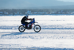 An electric bike on the mile long track at the Baikal Mile Ice Speed Festival. Maksimiha, Siberia, Russia. Friday, February 28, 2020. Photography ©2020 Michael Lichter.