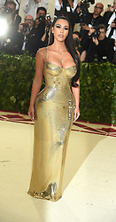 Kim Kardashian in Versace attends the Costume Institute Benefit at the Metropolitin Museum of Art at the opening of Heavenly Bodies: Fashion and the Catholic Imagination on May 7, 2018 in New York, New York, USA.
