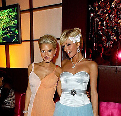 """Paris Hilton releases a photo on Twitter with the following caption: """""""".@ParisHilton & @JessicaSimpson during The 61st Golden Globe Awards - NBC Access Hollywood After Party at The Stardust Room at The Beverly Hilton in Beverly Hills on January 26, 2004. 👯♀️"""""""". Photo Credit: Twitter *** No USA Distribution *** For Editorial Use Only *** Not to be Published in Books or Photo Books ***  Please note: Fees charged by the agency are for the agency's services only, and do not, nor are they intended to, convey to the user any ownership of Copyright or License in the material. The agency does not claim any ownership including but not limited to Copyright or License in the attached material. By publishing this material you expressly agree to indemnify and to hold the agency and its directors, shareholders and employees harmless from any loss, claims, damages, demands, expenses (including legal fees), or any causes of action or allegation against the agency arising out of or connected in any way with publication of the material."""